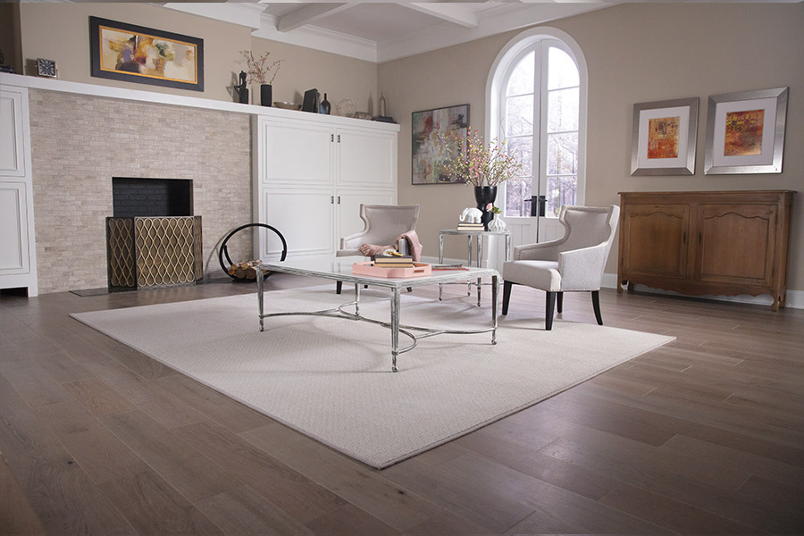White area rug on hardwood floor in Scarsdale, NY from Kanter's Carpet & Design Center