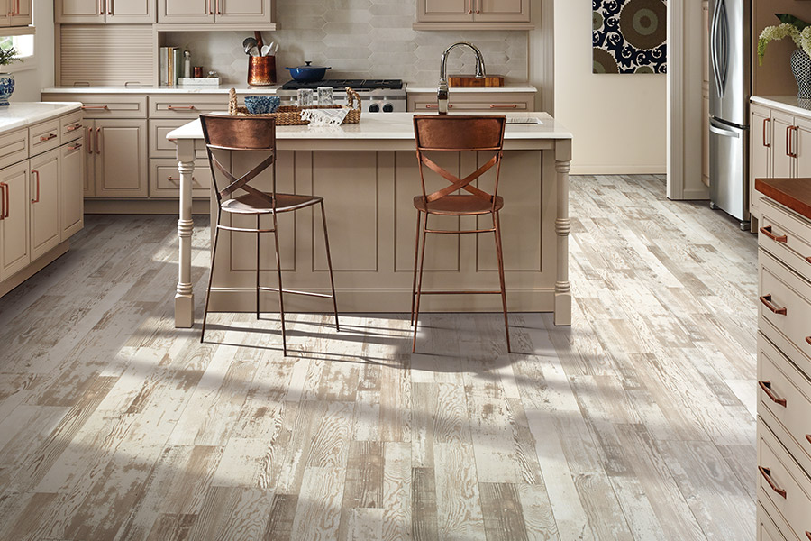 Wood look laminate kitchen floors in Dunn County WI from Nevins Flooring