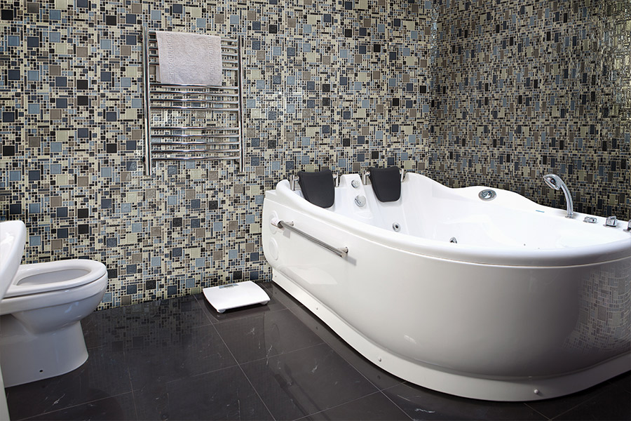 Glass tile bathtub surround in Benbrook, TX from Texas Designer Flooring