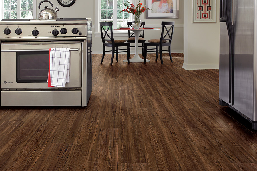 Wood look waterproof flooring for the kitchen in Cypress, CA from Bixby Plaza Carpets & Flooring