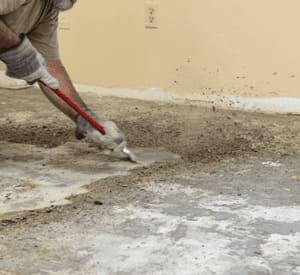 A member of our professional team preparing floors for installation in Redlands, CA