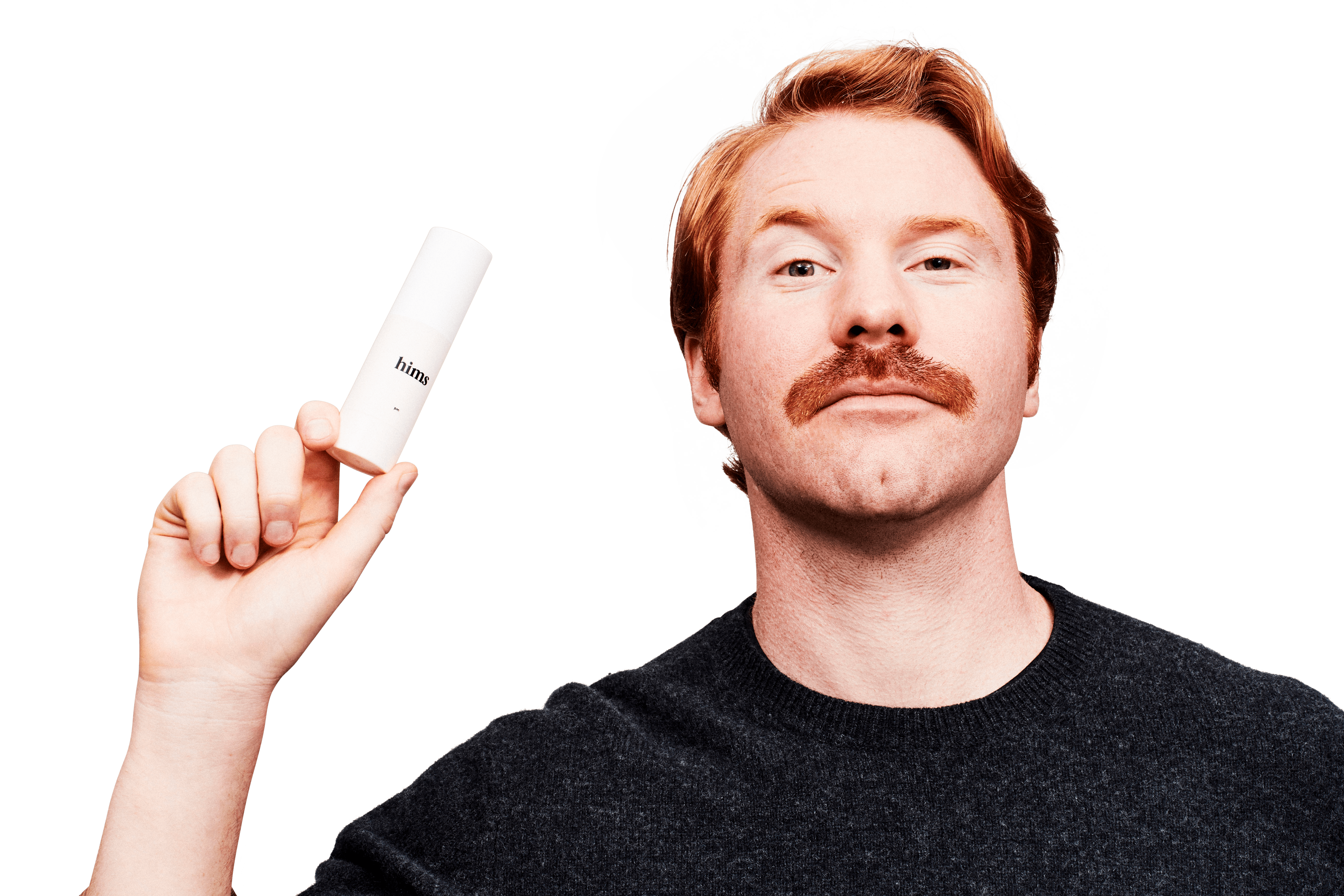 A moustached man holding up a bottle of anti-aging cream