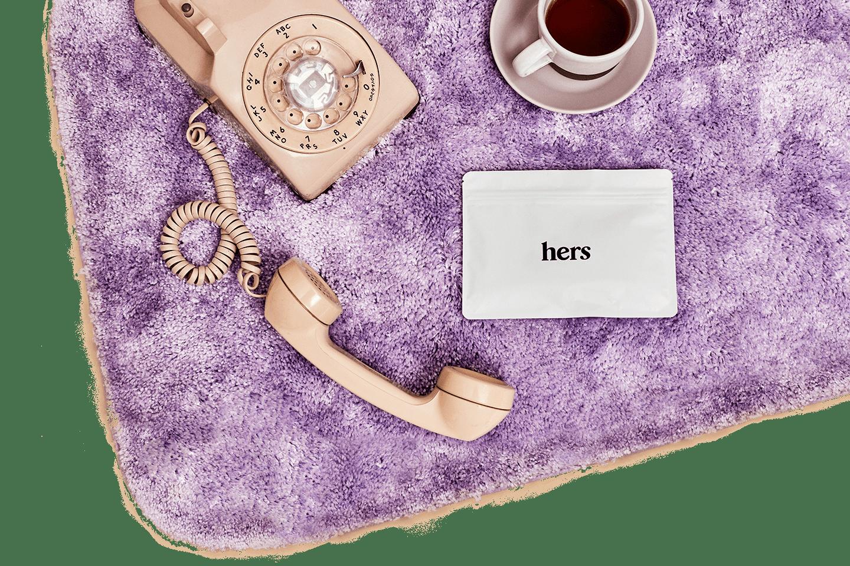 phone on purple bathmat