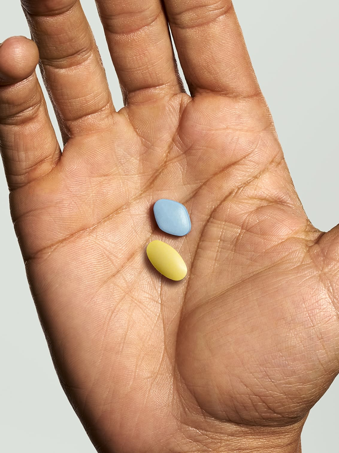 Two pills in someone's hand