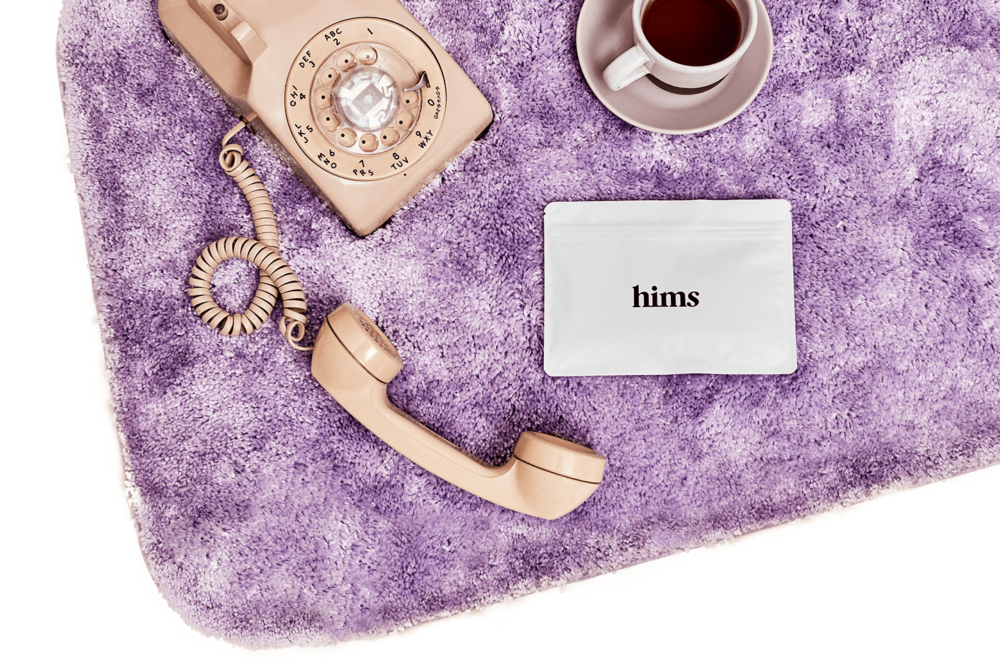 phone on purple bath mat
