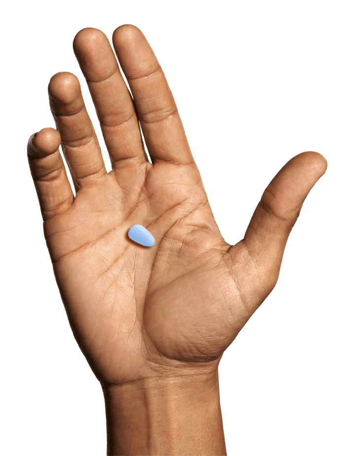 Hand with pill on palm