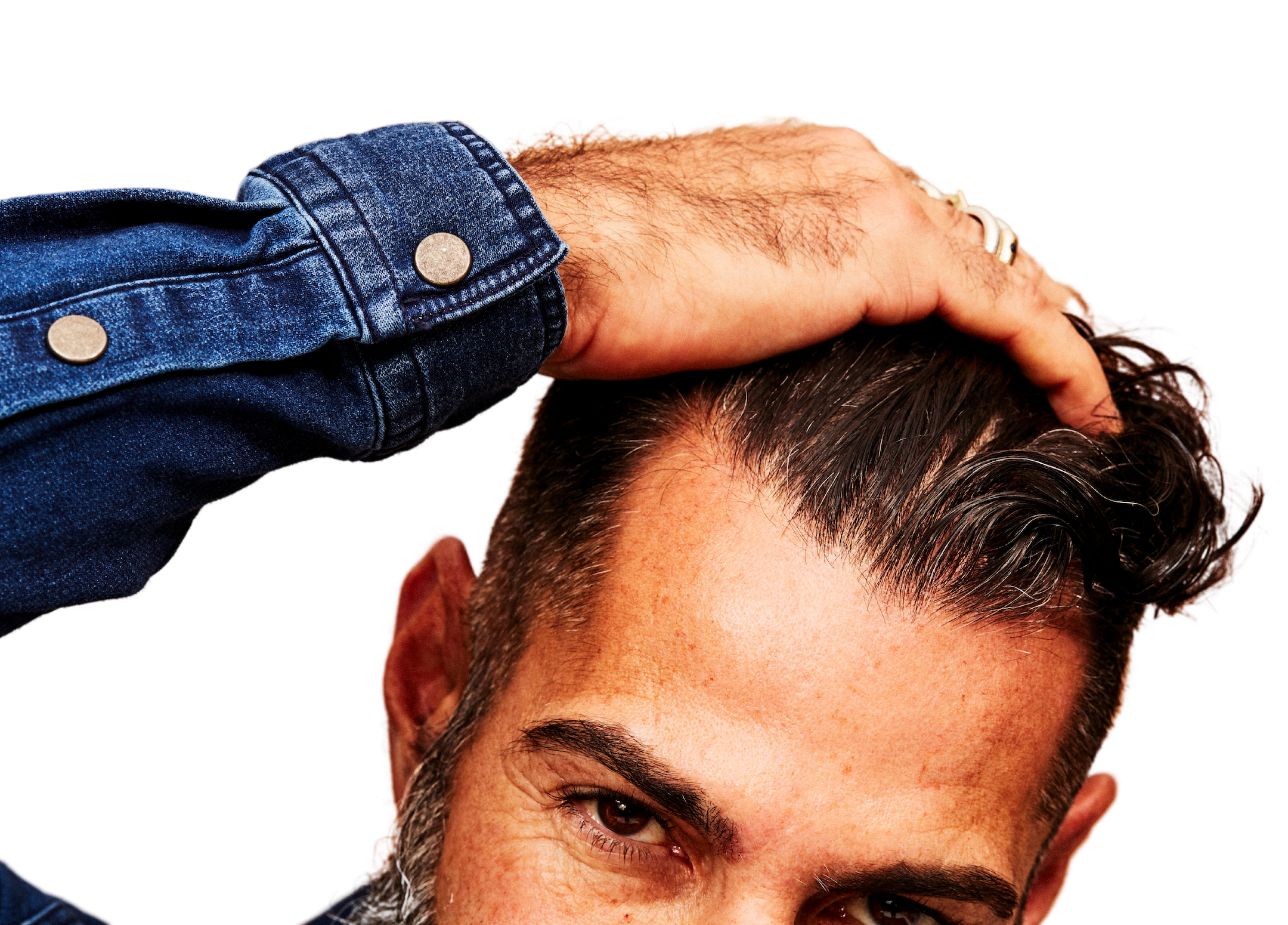 Man with hand in hair