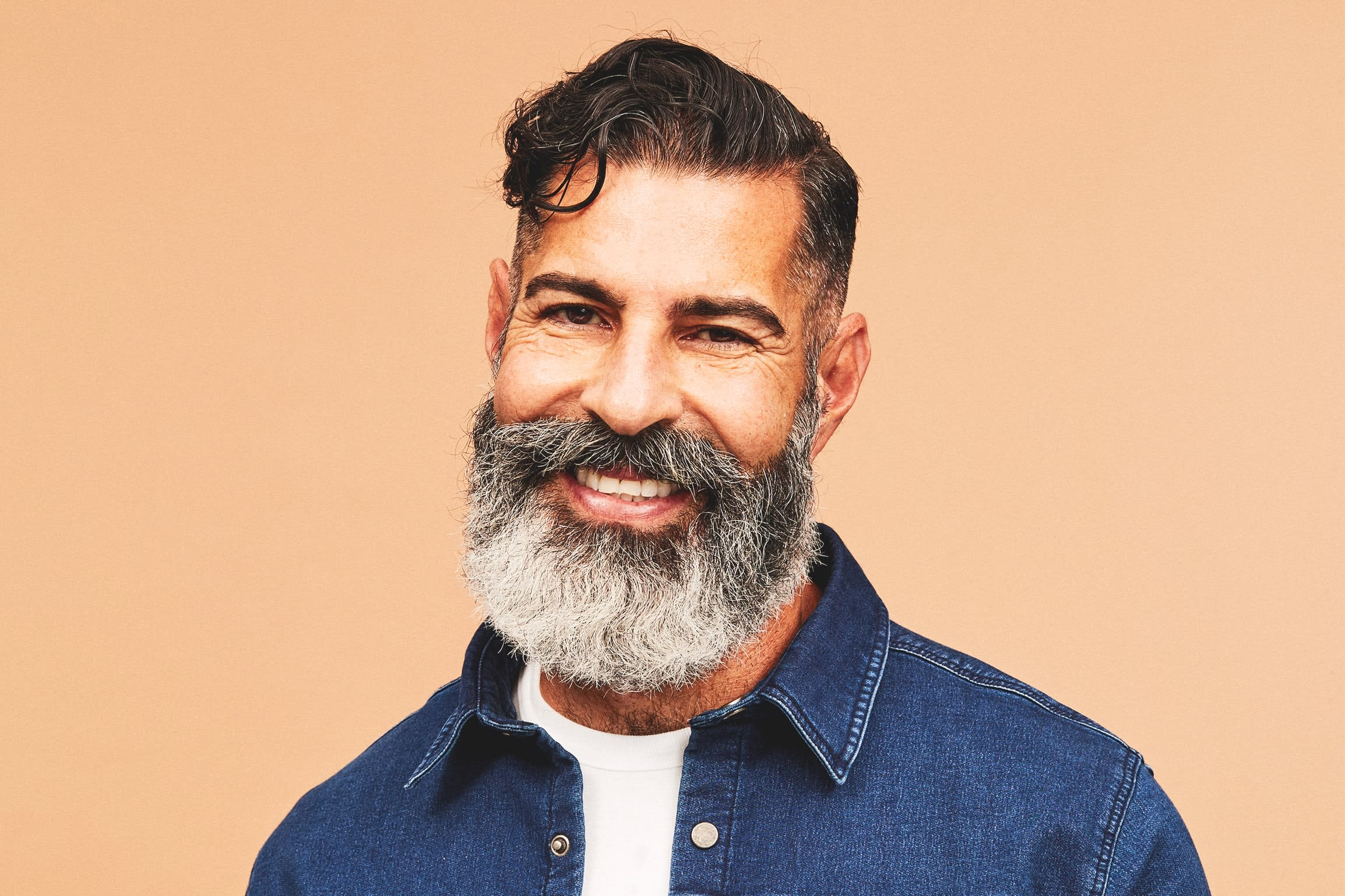 A smiling man with a full beard
