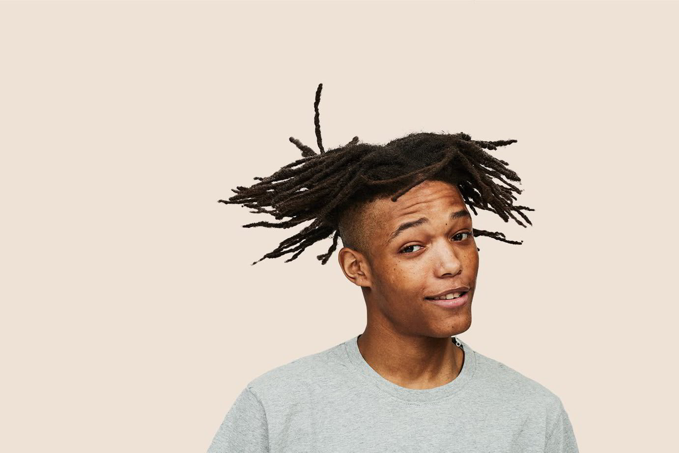A young man showing off his hair