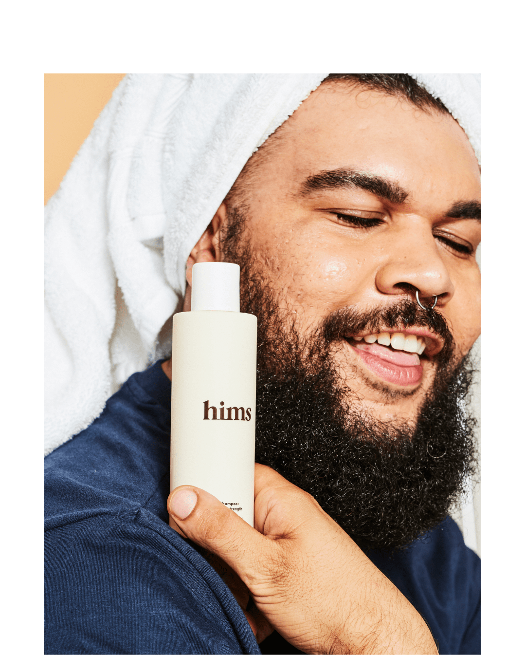 Man showing Hims product
