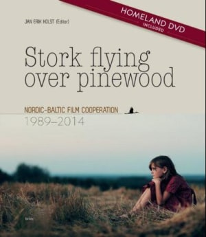 Stork flying over pinewood