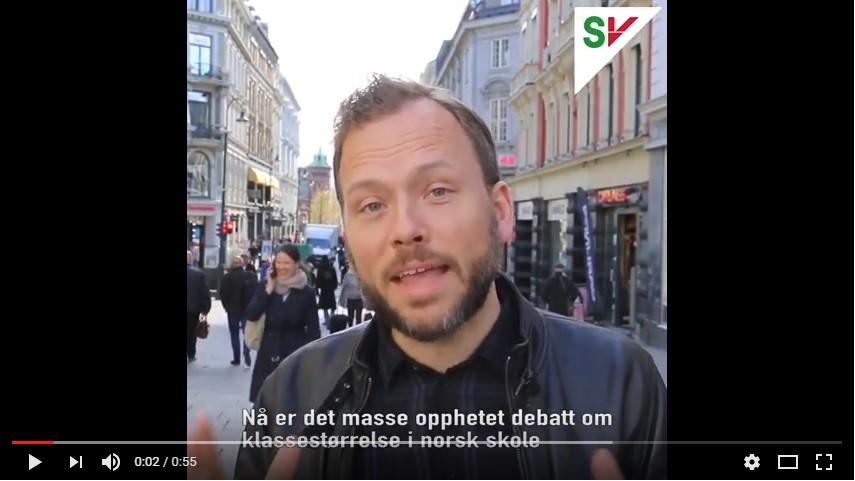 Skjermdump av valgkampvideo laget av SV. Audun Lysbakken i fokus med gatebilde fra Karl Johan i bakgrunnen.