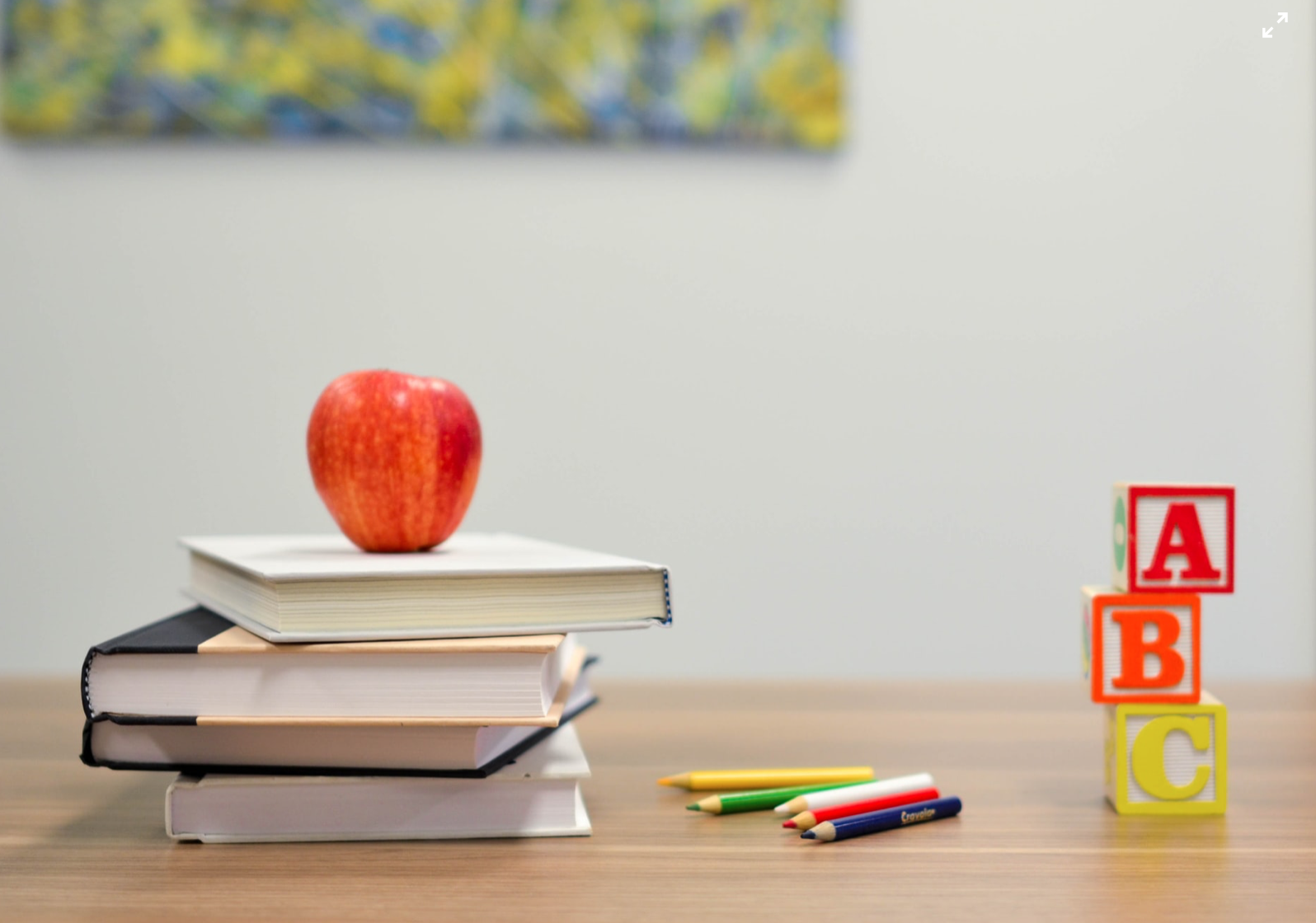 Picture of apple, building blocks, and books.