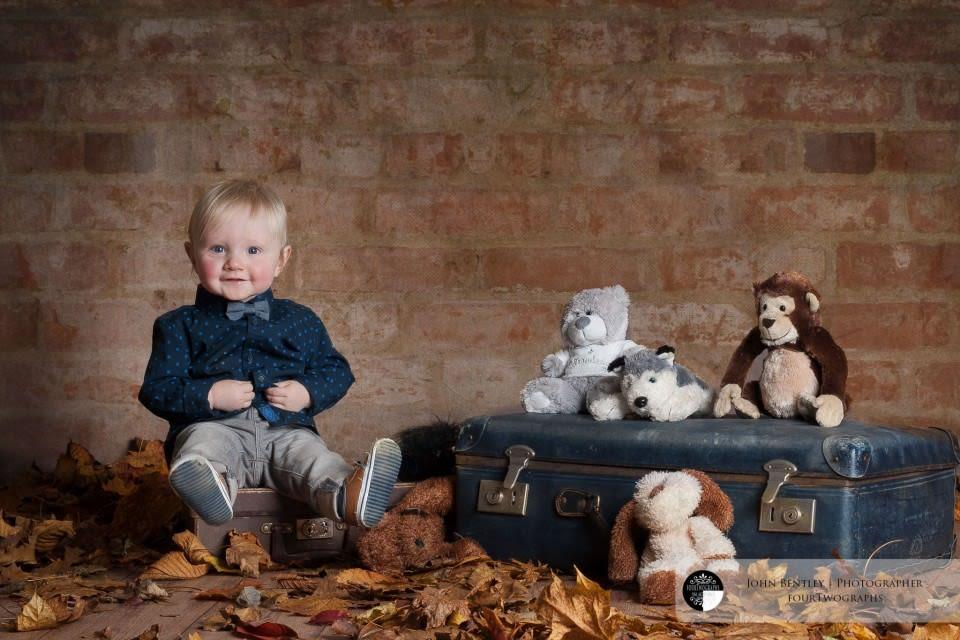 Little boy on suitcase