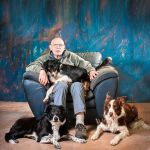 Gentleman with three collies