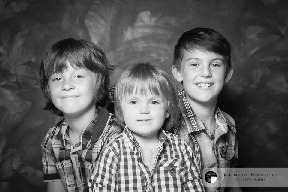 Three boys and a box of raisins