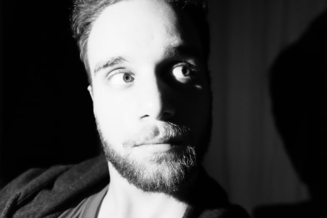 Me in black and white, a bit scruffy. Intense light on one side, and looking at the other, where there's shadows.