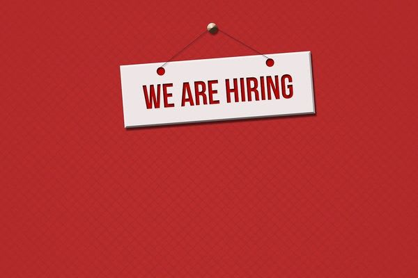 AI in Recruitment blog - illustration of a sign saying 'we are hiring'