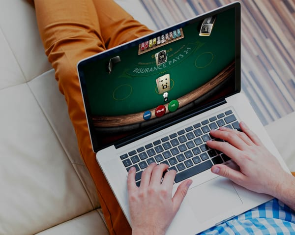 Photo of someone playing online poker game on laptop
