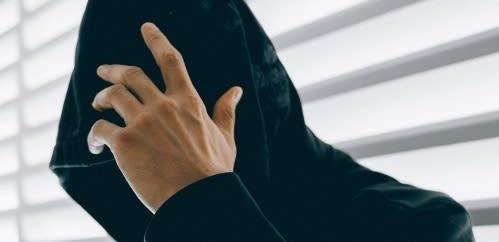 Hacker hiding face