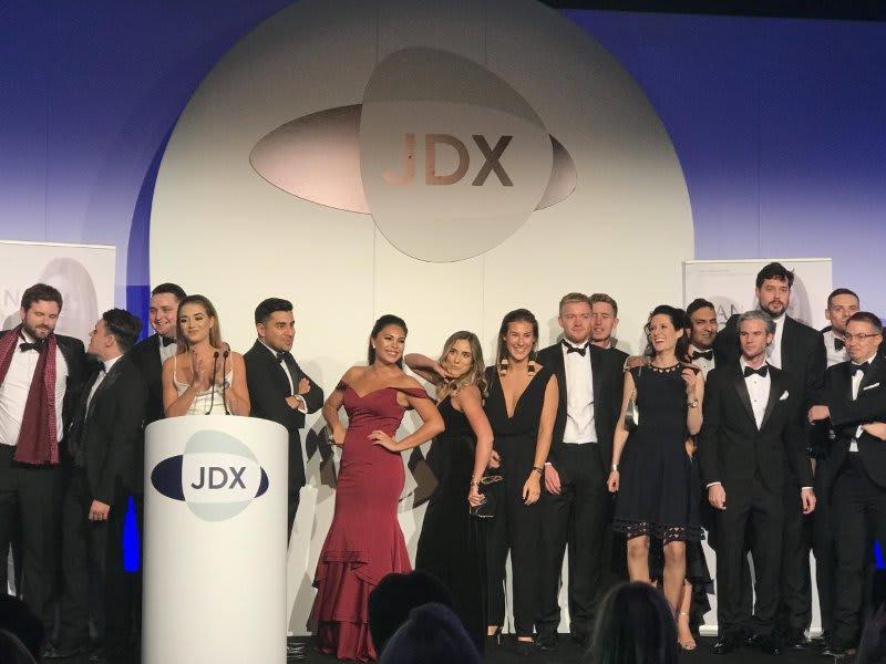 Staff from JDX in evening wear