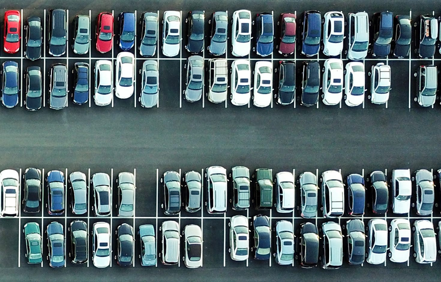 aerial overhead view of parked cars of many different types and varieties