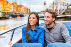 Couple cruising the canals of Copenhagen