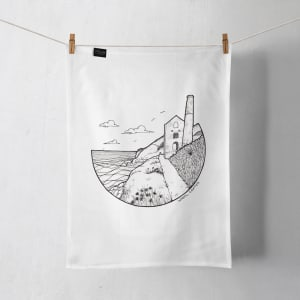 A Wheal Coates tea towel hanging on a line