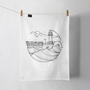 A St Ives tea towel hanging on a line