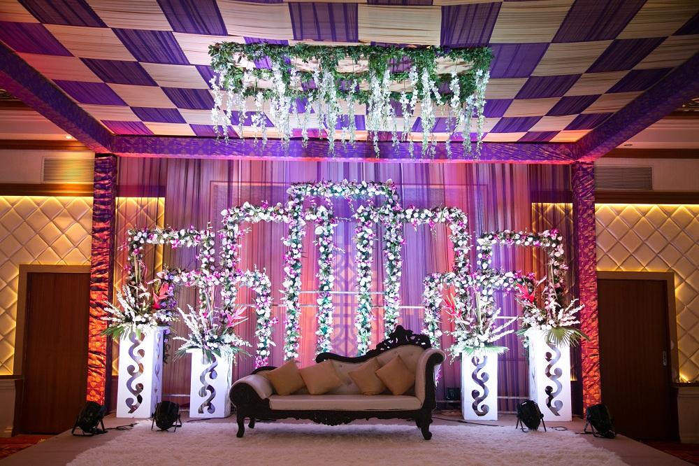 Panacea Entertainment | floral decor | floral stage decor | wedding decor ideas | Purple and Pink Decor | Function Mania