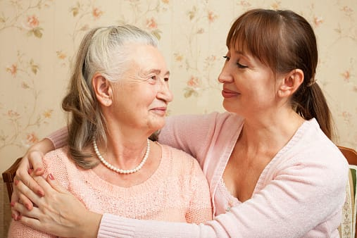 An elderly mom and daughter having a conversation about funeral planning, representing the funeral comparison website Funeralocity