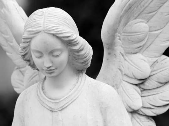 Stone angel statue. A funeral announcement is a way to provide people with information regarding funeral service arrangements.