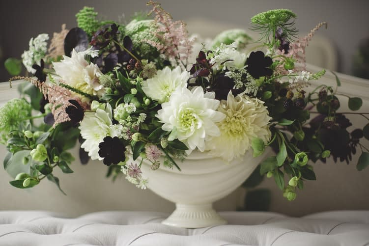Flowers in a white bowl representing funeral insurance as explained by funeral comparison website Funeralocity