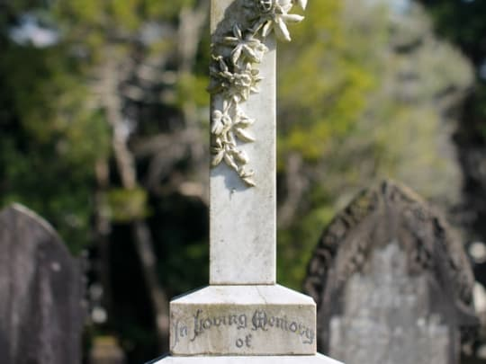 A grey headstone in tribute to a loved one who was cremated by a funeral home listed on Funeralocity in New York, NY