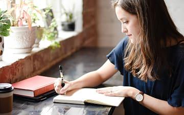 Woman writing, hannah olinger ©