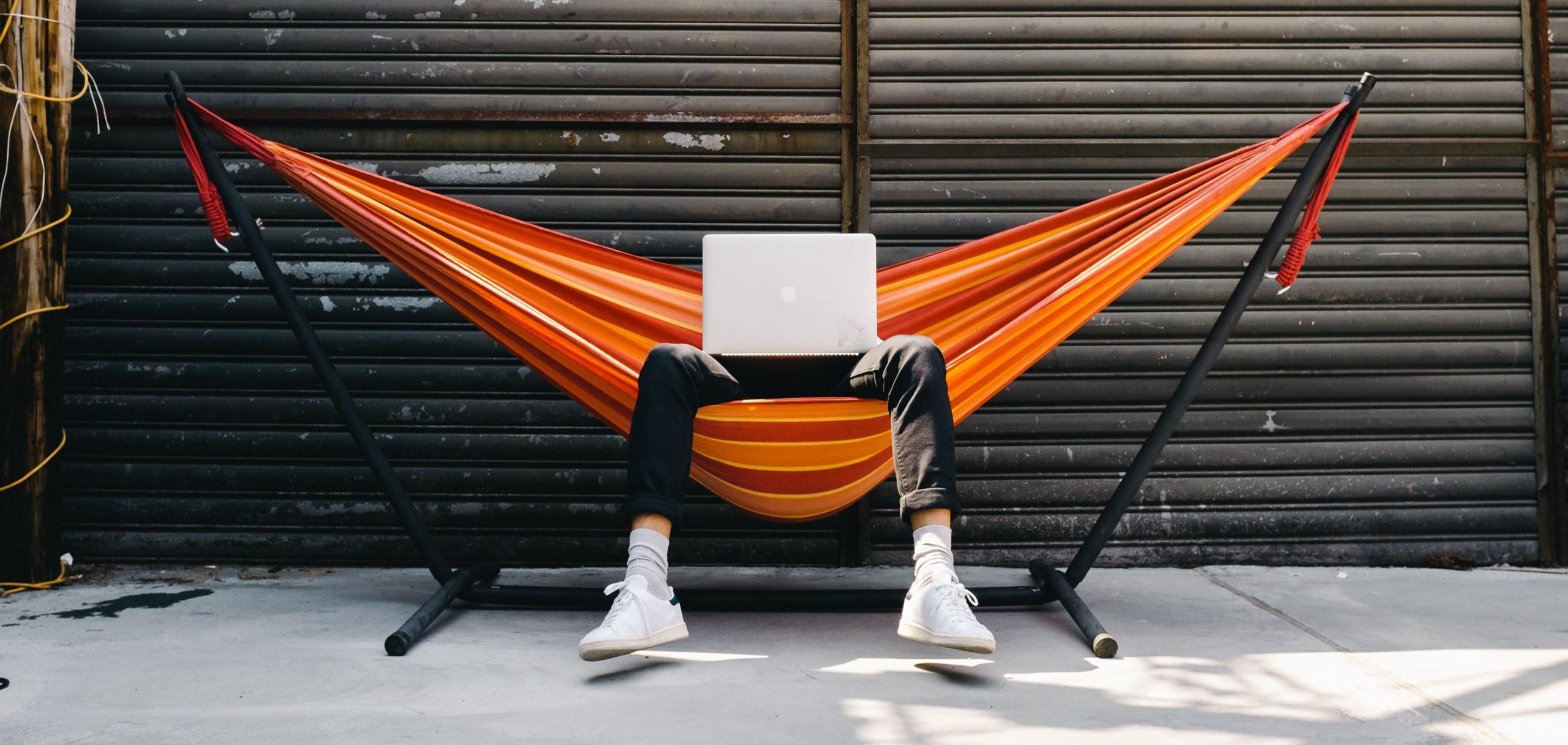 Fuzz employee sitting in a hammock