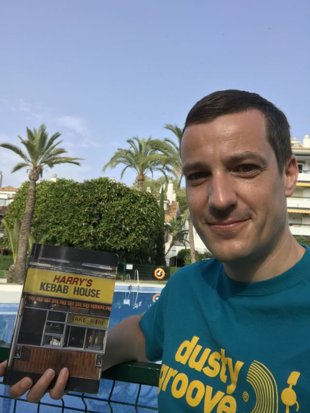 "Laurence with a copy of ""Harry's Kebabs"" by Russ Forman"