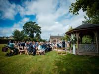 Civil Ceremony on Farmhouse Green M Photo Credit Aimee Kirkham