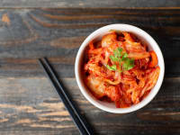 Kimchi and Chopsticks on Wooden Table