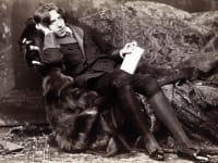 Oscar Wilde Posing on Chair Holding Book