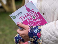 Thame Food Festival Guide in hand