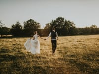 Tythe Barn Wedding Couple Walking in Field