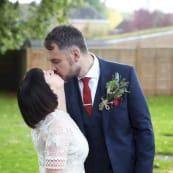 Real Wedding Hannah and James Kissing