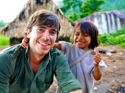 Simon Reeve with village child
