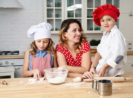 Mum Cooking With Her Young Children