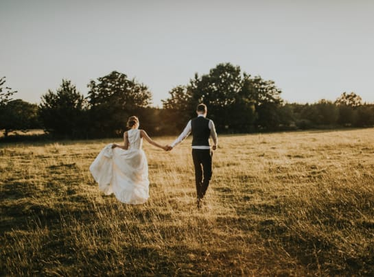 Tythe Barn Wedding Couple Walking in Field