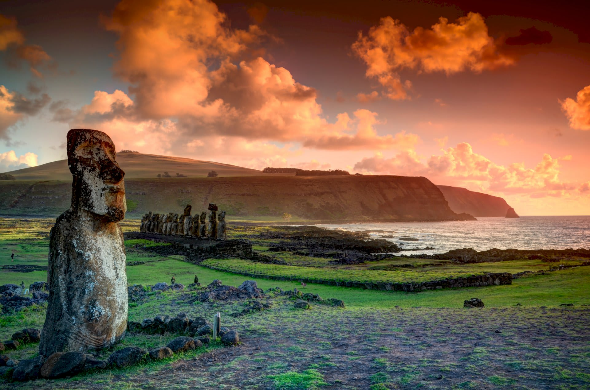 EASTER ISLAND The Riddle of the Pacific Moai against the cliff