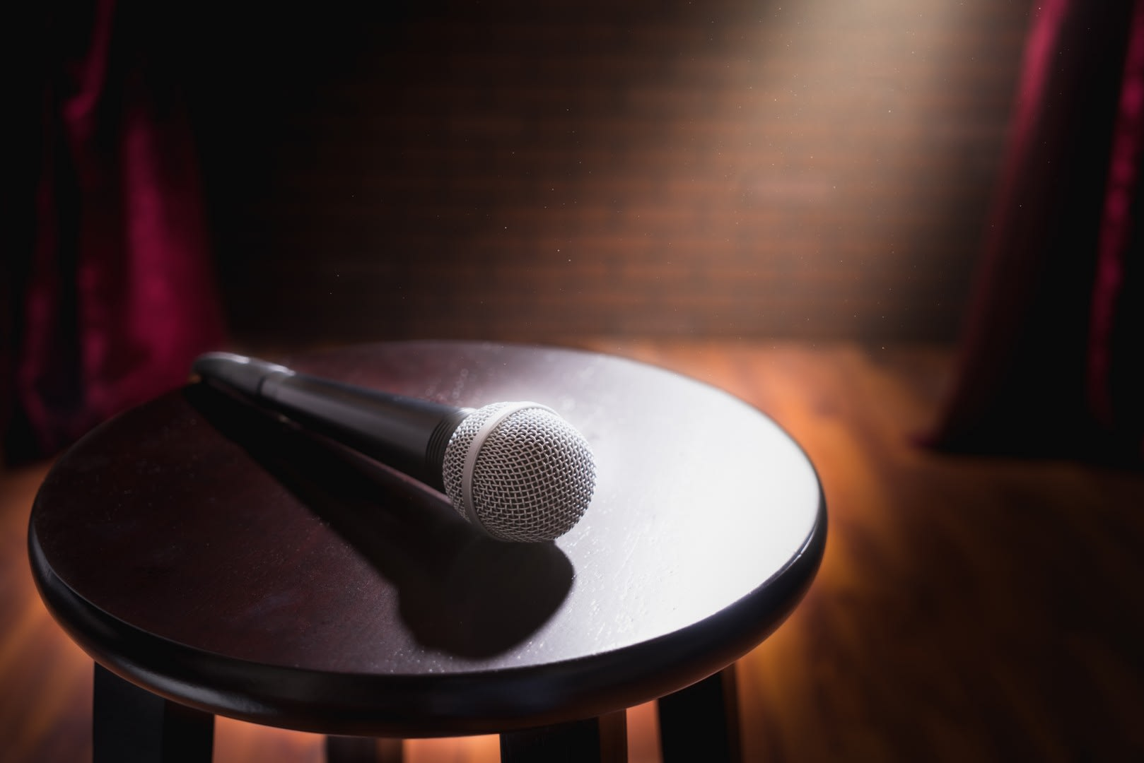 Different Times Stand Up Comedy Stool and Microphone
