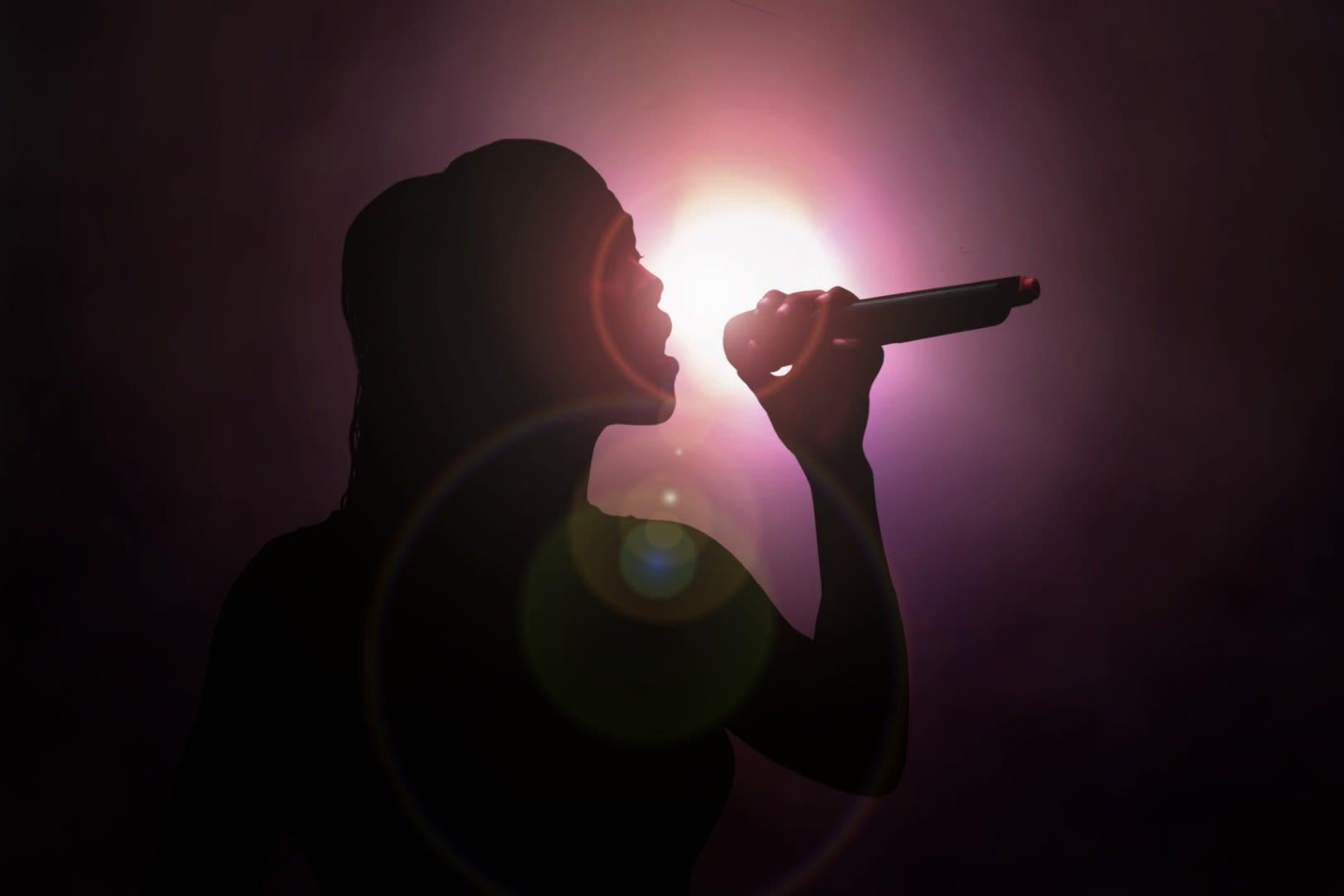 Alexandra Burke Woman Sings Under Spotlight