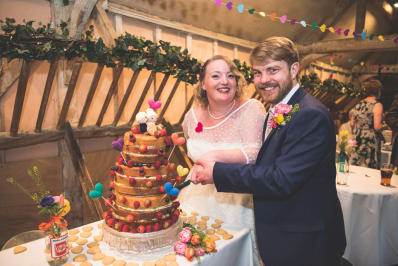 Real Wedding Chris Rachel cutting the cake